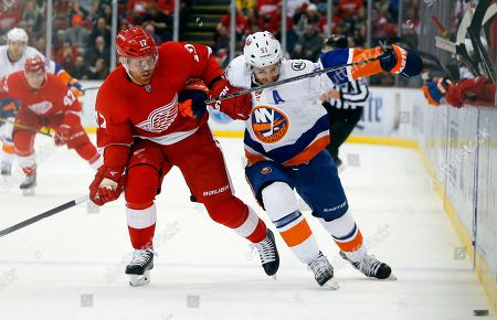 Detroit Red Wings center Brad Richards (17) and New York Islanders center Frans Nielsen (51) battle for the puck in the first period of an NHL hockey game in Detroit