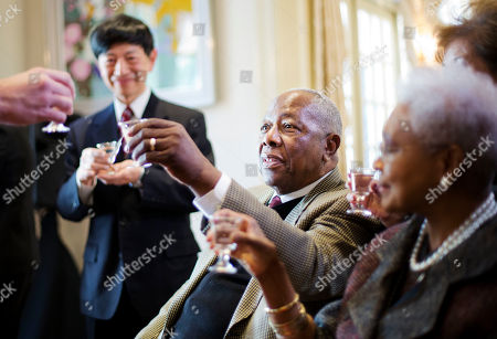 Hank Aaron, Takashi Shinozuka, Billye Aaron Hank Aaron, center, joins a toast with Consul General of Japan in Atlanta Takashi Shinozuka, rear, and Aaron's wife Billye, right, after being presented with the Order of the Rising Sun, Gold Rays with Rosette, by Shinozuka at his official residence, in Atlanta. Japan has honored the former home run king with one of its highest awards, bestowing the Order of the Rising Sun for bringing young people and countries together through baseball