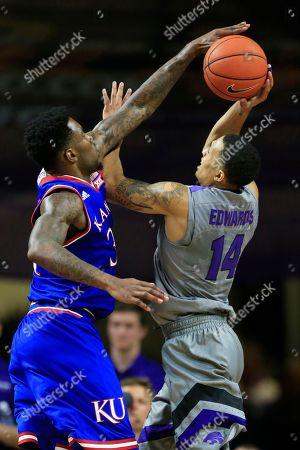 Jamari Traylor, Justin Edwards Kansas forward Jamari Traylor, left, blocks a shot by Kansas State guard Justin Edwards (14) during the first half of an NCAA college basketball game in Manhattan, Kan