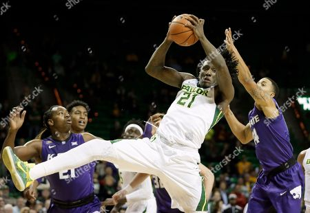 Taurean Prince, D.J. Johnson, Justin Edwards Baylor's Taurean Prince (21) comes down with a rebound in front of Kansas State's D.J. Johnson, left, and Justin Edwards, right, in the second half of an NCAA college basketball game, in Waco, Texas. Baylor won in double overtime, 79-72
