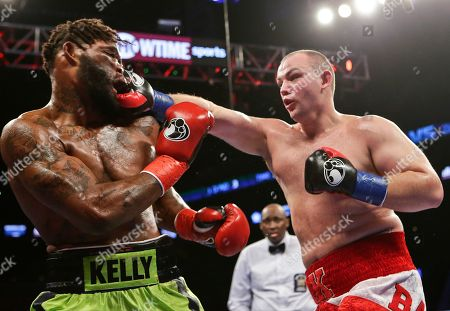 Stock Image of Adam Kownacki, Danny Kelly Adam Kownacki, right, punches Danny Kelly, left, during the third round of a boxing match, in New York. Kownacki won the fight