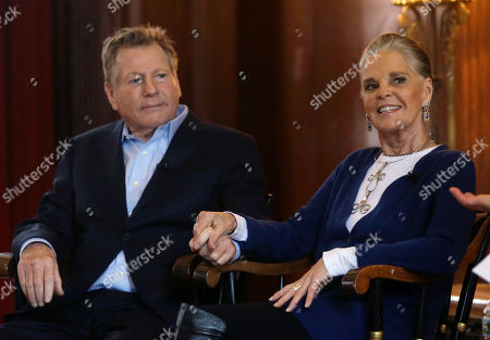 """Ryan O'Neal, Ali MacGraw Actors Ryan O'Neal, left, and Ali MacGraw hold hands as they are introduced for a talk with students on the campus of Harvard University in Cambridge, Mass., more than 45 years after the release of their 1970 classic """"Love Story."""" The duo, now in their 70s, currently are co-starring in a national tour of """"Love Letters,"""" which is about a man and a woman who maintain contact over 50 years through notes, cards and letters"""
