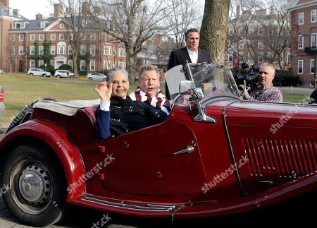 """Ali MacGraw, Ryan O'Neal Actors Ali MacGraw, left, and Ryan O'Neal drive up in an antique MG convertible on the campus of Harvard University in Cambridge, Mass., more than 45 years after the release of their 1970 classic """"Love Story."""" The duo, now in their 70s, currently are co-starring in a national tour of """"Love Letters,"""" which is about a man and a woman who maintain contact over 50 years through notes, cards and letters"""