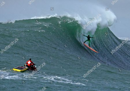 Stock Image of Nic Lamb Nic Lamb surfs a giant wave during the finals of the Mavericks surfing contest, in Half Moon Bay, Calif. Lamb won the event