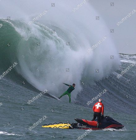 Nic Lamb Nic Lamb surfs a giant wave during the finals of the Mavericks surfing contest, in Half Moon Bay, Calif. Lamb won the Mavericks surfing contest