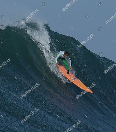 Nic Lamb Nic Lamb rides a giant wave during the fourth heat of the Mavericks surfing contest, in Half Moon Bay, Calif. Lamb won the contest