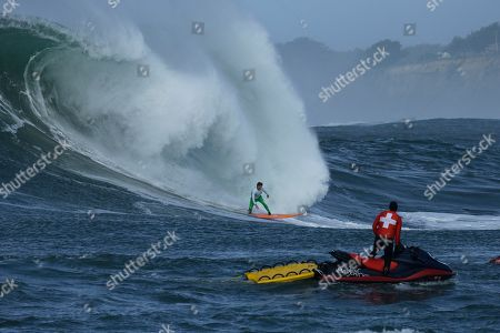Stock Picture of Nic Lamb Nic Lamb rides a giant wave during the fourth heat of the Mavericks surfing contest, in Half Moon Bay, Calif. Lamb won the contest