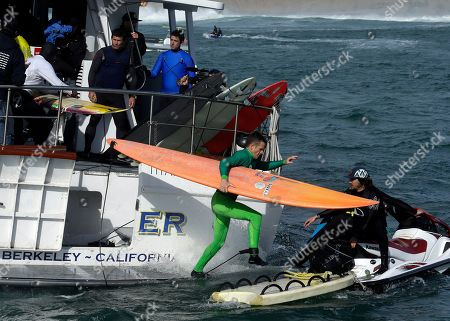 Stock Photo of Nic Lamb Nic Lamb jumps to a jet ski with his board during the finals of the Mavericks surfing contest,in Half Moon Bay, Calif. Lamb won the event