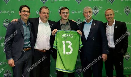 Jordan Morris Jordan Morris, center, poses for a photo with (from left) Seattle Sounders FC owner Adrian Hanauer, general manager Garth Lagerwey, head coach Sigi Schmid, and sporting director Chris Henderson, in Seattle after the MLS soccer team announced Morris' signing as a forward. Morris, who played for Stanford, was the Hermann Trophy winner in 2015 as the top college player in the country
