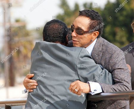 Smokey Robinson Singer Smokey Robinson, right, embraces an unidentified man as he arrives for the funeral of singer Natalie Cole at West Angeles Church of God in Christ in the Crenshaw district of Los Angeles