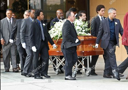 Stock Photo of Jesse Jackson Pallbearers carry the casket of Natalie Cole after funeral services at West Angeles Church of God in Christ in the Crenshaw district of Los Angeles, . The Rev. Jesse Jackson follows at far left. The R&B singer Cole died on New Year's eve at age 65