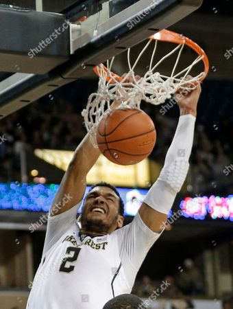Devin Thomas Wake Forest's Devin Thomas (2) dunks against North Carolina State in the first half of an NCAA college basketball game in Winston-Salem, N.C