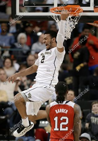 Devin Thomas, Anthony Barber Wake Forest's Devin Thomas (2) celebrates after a dunk against North Carolina State's Anthony Barber (12) during the second half of an NCAA college basketball game in Winston-Salem, N.C., . Wake Forest won 77-74