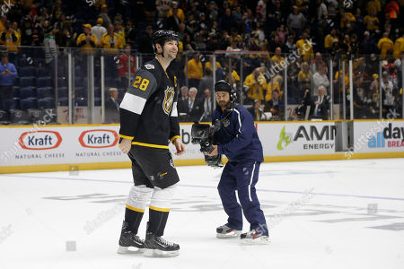 John Scott Pacific Division forward John Scott skates off the ice after being named most valuable player following the NHL hockey All-Star championship game, in Nashville, Tenn