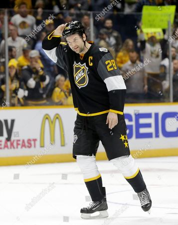 John Scott Pacific Division forward John Scott (28) skates off the ice after the Pacific Division beat the Atlantic Division 1-0 to win the NHL hockey All-Star championship game, in Nashville, Tenn. Scott was named most valuable player