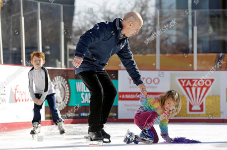 Scott Hamilton, Hanna Madson Olympic figure skating gold medalist Scott Hamilton helps Hanna Madson, 3, as she tries skating on an outdoor rink set up for the NHL hockey All-Star game festivities, in Nashville, Tenn. Hamilton skated with patients who have received treatment at Monroe Carell Jr. Children's Hospital at Vanderbilt. The All Star game is scheduled to be played Sunday, Jan. 31