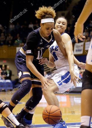 Brianna Turner, Faith Suggs Notre Dame's Brianna Turner (11) dribbles as Duke's Faith Suggs defends during the second half of an NCAA college basketball game in Durham, N.C