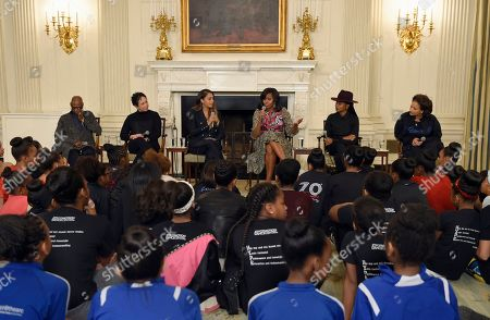 """Michelle Obama, Judith Jamison, Virginia Johnson, Alani Nicole Anthony, Fatima Robinson, Debbie Allen First lady Michelle Obama speaks in the State Dining Room of the White House in Washington, during a Black History month event highlighting the contributions African American women have made to dance. Obama hosted a day-long dance workshop for local students. Obama is joined by, from left, Alvin Ailey American Dance Theater's Judith Jamison, Dance Theatre of Harlem's Virginia Johnson, Alani Nicole """"La La"""" Anthony, Hip-Hop choreographer Fatima Robinson and Debbie Allen"""
