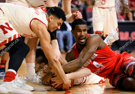 Tai Webster, Daniel Giddens, Jack McVeigh Nebraska's Tai Webster, left, Jack McVeigh, center, and Ohio State's Daniel Giddens (4) struggle for a loose ball during the second half of an NCAA college basketball game in Lincoln, Neb., . Ohio State won 65-62 in overtime