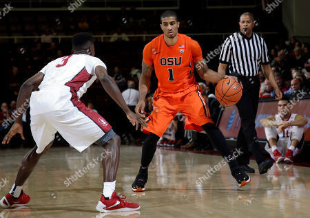Gary Payton II, Malcolm Allen Oregon State guard Gary Payton II (1) is defended by Stanford guard Malcolm Allen (3) during the first half of an NCAA college basketball game, in Stanford, Calif