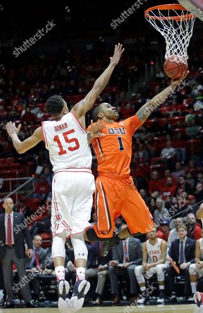 Gary Payton II, Lorenzo Bonam Oregon State guard Gary Payton II (1) goes to the basket as Utah guard Lorenzo Bonam (15) defends during the first half of an NCAA college basketball game, in Salt Lake City
