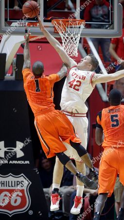 Jakob Poeltl, Gary Payton II Utah forward Jakob Poeltl (42) defends against Oregon State guard Gary Payton II (1) during the second half of an NCAA college basketball game, in Salt Lake City. Utah won 59-53