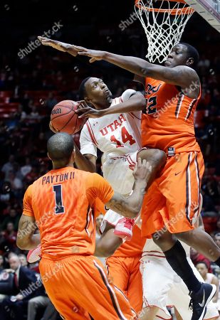 Dakarai Tucker, Jarmal Reid, Gary Payton II Utah forward Dakarai Tucker, center, goes to the basket as Oregon State's Jarmal Reid, right, defends as Gary Payton II, left, looks on during the second half of an NCAA college basketball game, in Salt Lake City. Utah won 59-53