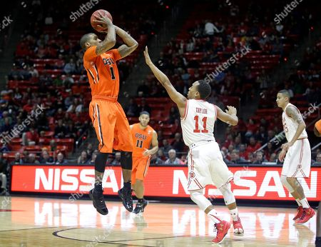Gary Payton II, Brandon Taylor Oregon State guard Gary Payton II (1) shoots as Utah guard Brandon Taylor (11) defends during the first half of an NCAA college basketball game, in Salt Lake City