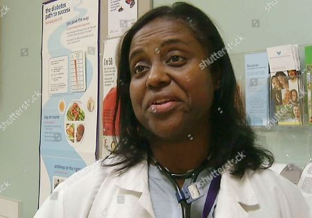 In this still photo from video, Dr. Michelle Johnson discusses prescriptions for exercise that she issues to patients at Whittier Street Health Center in Boston's Roxbury neighborhood. Doctors treating chronic health problems increasingly are prescribing exercise instead of medicines for their patients. At one health center in Boston, primary care physicians, internists and psychologists prescribe access to a gym for $10 a month