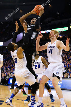 Stock Photo of Toby Hegner, James Milliken, Geoffrey Groselle, Maurice Watson Jr., Kris Dunn Providence's Kris Dunn (3) is fouled on the way to the basket by Creighton's Maurice Watson Jr. (10), with Geoffrey Groselle (41) James Milliken (23) and Toby Hegner (32) watching, during the second half of an NCAA college basketball game in Omaha, Neb., . Providence won 50-48