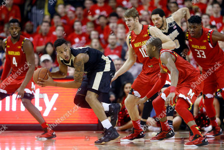 Robert Carter, Jake Layman, Rasheed Sulaimon, Diamond Stone, Vince Edwards Purdue forward Vince Edwards, second from left, looks for a teammate as he is pressured by Maryland forward Robert Carter (4), forward Jake Layman (10), guard Rasheed Sulaimon, second from right, and center Diamond Stone (33) in the second half of an NCAA college basketball game, in College Park, Md. Maryland won 72-61
