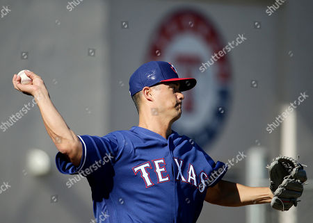 Jeremy Guthrie Texas Rangers pitcher Jeremy Guthrie throws during spring training baseball practice, in Surprise, Ariz