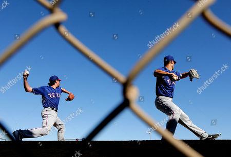 Jeremy Guthrie, Nick Tepesch Texas Rangers pitchers Nick Tepesch, left, and Jeremy Guthrie throw during spring training baseball practice, in Surprise, Ariz