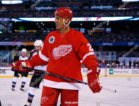 Chris Chelios Detroit Red Wings defenseman Chris Chelios wears a sweater signed by teammates during the first period against the Colorado Avalanche in a Stadium Series alumni hockey game at Coors Field in Denver on . Colorado won 5-2