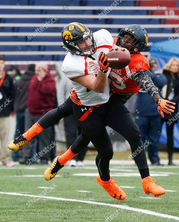 K.J. Dillon, Henry Krieger-Coble West Virginia safety K.J. Dillon (29) attempts the block against Iowa tight end Henry Krieger-Coble (82) during NCAA college football practice for the Senior Bowl, at Ladd-Peebles Stadium, in Mobile, Ala