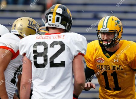 Carson Wentz, Henry Krieger-Coble North Dakota State quarterback Carson Wentz talks to Iowa tight end Henry Krieger-Coble during drills at an NCAA college football practice for the Senior Bowl, at Ladd-Peebles Stadium, in Mobile, Ala