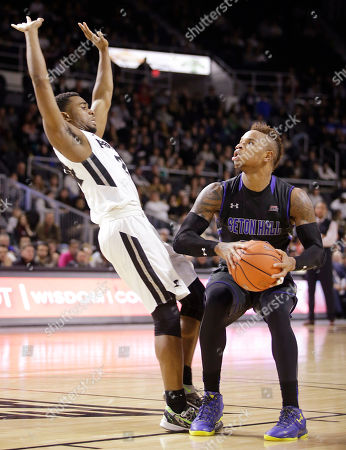 Jalen Lindsey, Derrick Gordon Providence guard Jalen Lindsey, left, tries to draw a charging foul as Seton Hall guard Derrick Gordon, right, sets up to shoot during the second half of an NCAA college basketball game, in Providence, R.I. Seton Hall defeated Providence 81-72