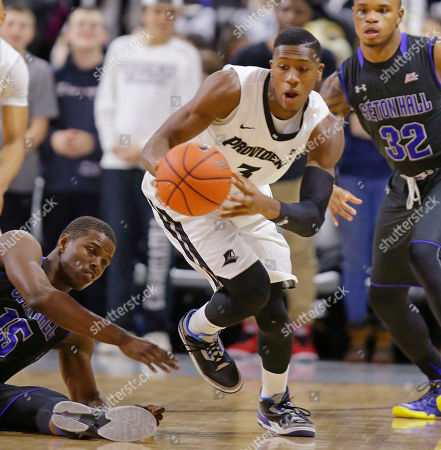 Kris Dunn, Derrick Gordon, Isaiah Whitehead Providence guard Kris Dunn (3) grags the ball between Seton Hall guards Derrick Gordon (32) and Isaiah Whitehead (15) during the first half of an NCAA college basketball game, in Providence, R.I