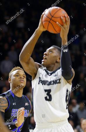 Kris Dunn, Derrick Gordon Providence guard Kris Dunn (3) drives to the hoop against Seton Hall guard Derrick Gordon (32) during the first half of an NCAA college basketball game, in Providence, R.I