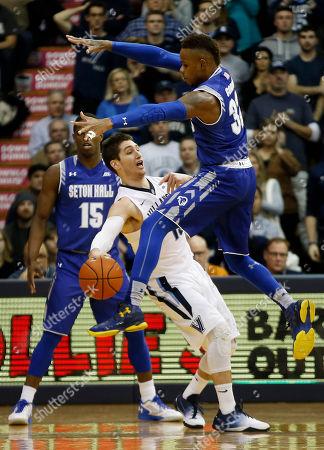 Ryan Arcidiacono, Derrick Gordon Seton Hall's Angel Delgado, right, tries to block a pass by Villanova's Ryan Arcidiacono during the first half of an NCAA college basketball game, in Villanova, Pa
