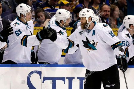 Justin Braun, Joe Thornton San Jose Sharks' Joe Thornton, right, is congratulated by teammate Justin Braun (61) after scoring during the second period of an NHL hockey game against the St. Louis Blues, in St. Louis