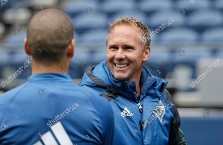 Chris Henderson Seattle Sounders sporting director Chris Henderson greets a player after a soccer training session, in Seattle. The Sounders play Club America in the CONCACAF Champions League quarterfinal round on Tuesday