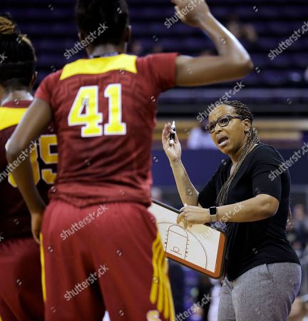 Cynthia Cooper-Dyke Southern California head coach Cynthia Cooper-Dyke, right, talks to her players, including Temi Fagbenle (41), during a timeout in the first half of an NCAA college basketball game against Washington, in Seattle