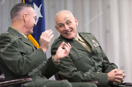 Stock Picture of John F. Kelly, Joseph F. Dunford Joint Chiefs Chairman Gen. Joseph Dunford, Jr., left, and outgoing Commander of the U.S. Southern Command, Marine Corps Gen. John F. Kelly, share a laugh during a change of command ceremony at U.S. Southern Command, in Miami