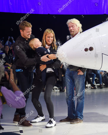 Sam Branson, Eva-Deia Branson, Richard Branson, Isabella Branson Sam Branson, left, and his wife Isabella help their daughter Eva-Deia christen Virgin Galactic's SpaceShipTwo space tourism rocket as Richard Branson, right, stands by after it was unveiled, in Mojave, Calif. The company is preparing to resume flight testing for the first time since a 2014 accident destroyed the original and killed one of its two pilots