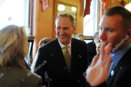 South Dakota Gov. Dennis Daugaard greets Secretary of State Shantel Krebs, left, shortly before giving his State of the State address to the South Dakota Legislature, at the state Capitol in Pierre, S.D