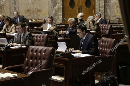 Republican Sen. Andy Hill works at his desk on the Senate floor during debate on a supplemental budget proposal, in Olympia, Wash. The proposal, which passed on a 25-22 vote, puts money toward repairing damage from last summer's wildfires and aiding the state's mental health system