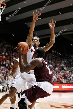 Shannon Hale Alabama forward Shannon Hale (11) guards the ball against Texas A&M guard Jalen Jones (12) during the first half of an NCAA college basketball game, in Tuscaloosa, Ala. Alabama won 63-62