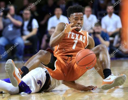 Isaiah Taylor, Justin Edwards Texas guard Isaiah Taylor (1) lands on Kansas State guard Justin Edwards while chasing the ball during the first half of an NCAA college basketball game in Manhattan, Kan