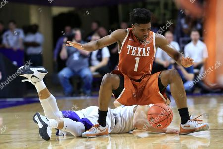 Isaiah Taylor, Justin Edwards Texas guard Isaiah Taylor (1) lands on Kansas State guard Justin Edwards while chasing a loose ball during the first half of an NCAA college basketball game in Manhattan, Kan